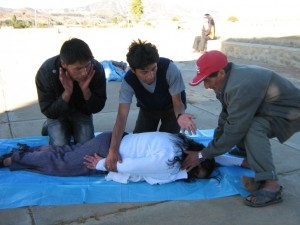 Health promoters practicing patient transport near Cochabamba