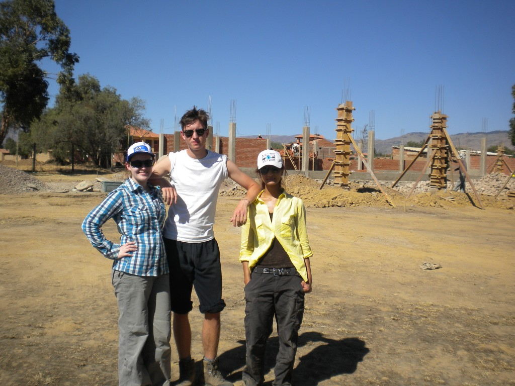Oxford volunteers Helena, Henry, and Abda at the Demonstration Center in August 2012.