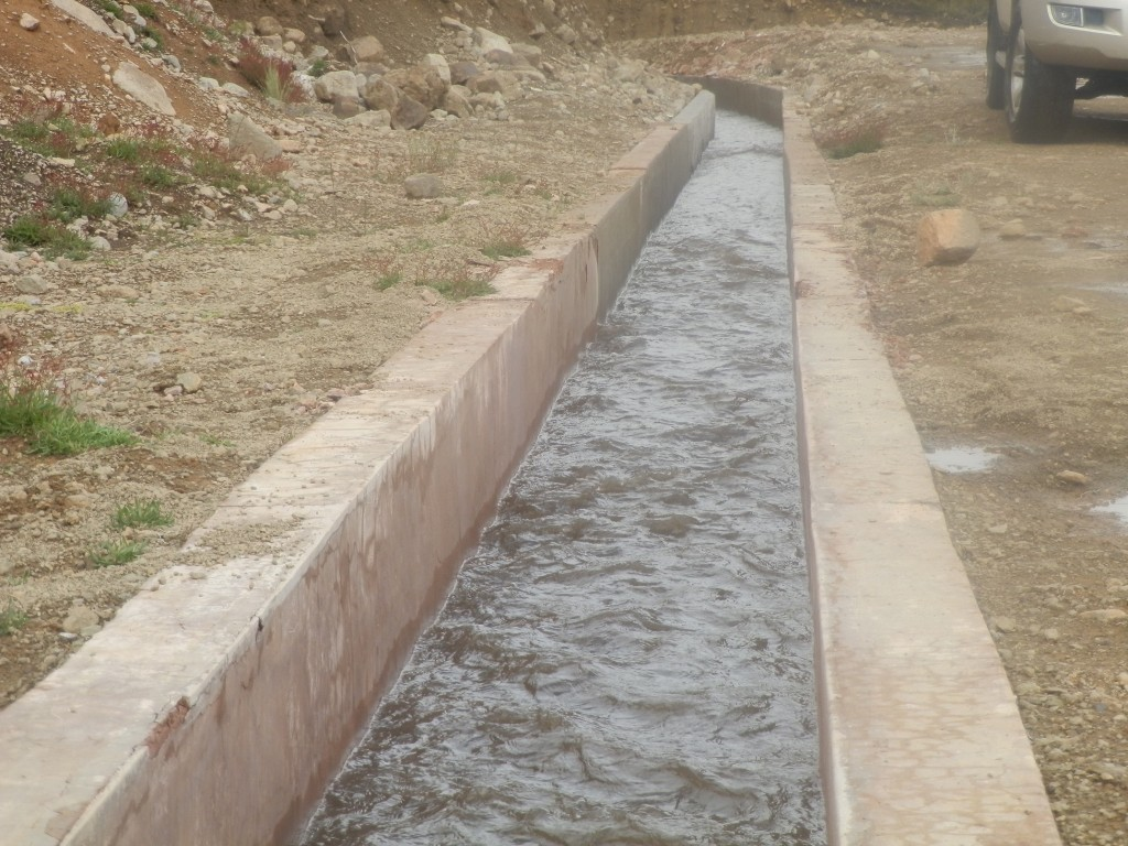 One of the concrete channels that direct snow melt from the mountain and rainwater to the reservoir.