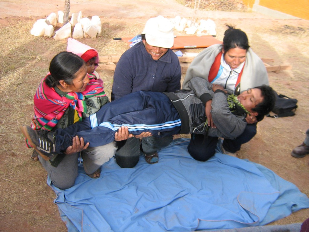 Volunteer health promoters in Copachunchu practicing how to move a patient.