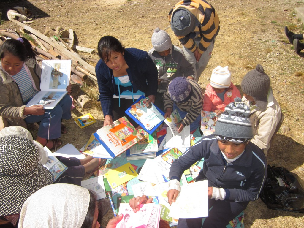 Donating books shipped from Mano a Mano to children in Sancayani, Bolivia.