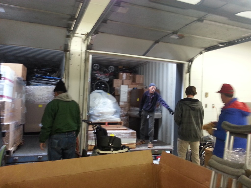 Loading 3 40-ft. Containers with 75,000 pounds of Supplies