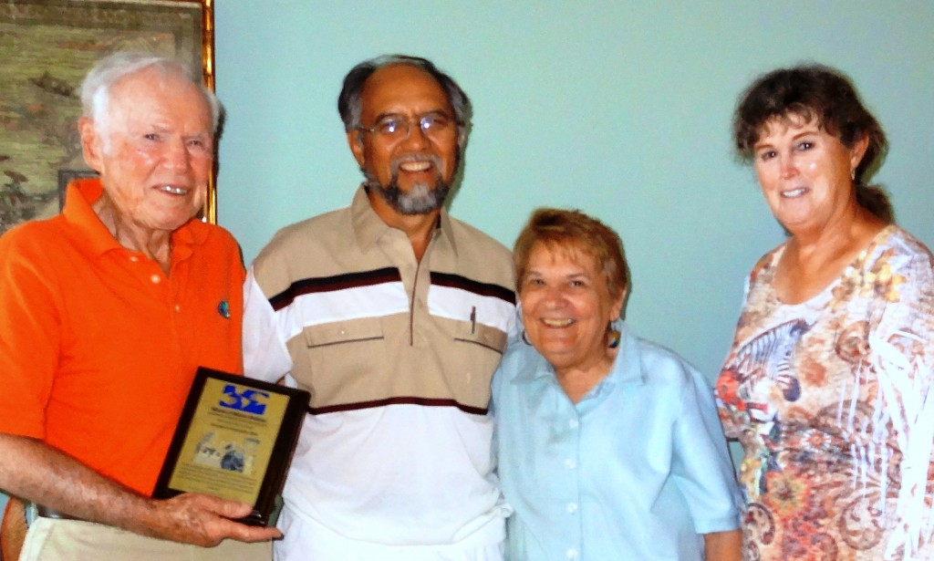 Joe and Charlotte Blitt (far left and far right, respectively) with Mano a Mano co-founders Segundo and Joan Velasquez and the dedication plaque for the new clinic!
