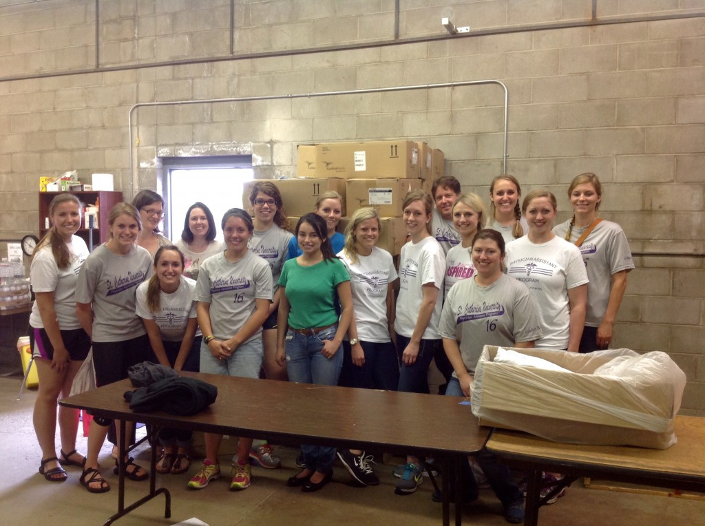 Volunteers from St. Kate's PA program at Mano a Mano in July.