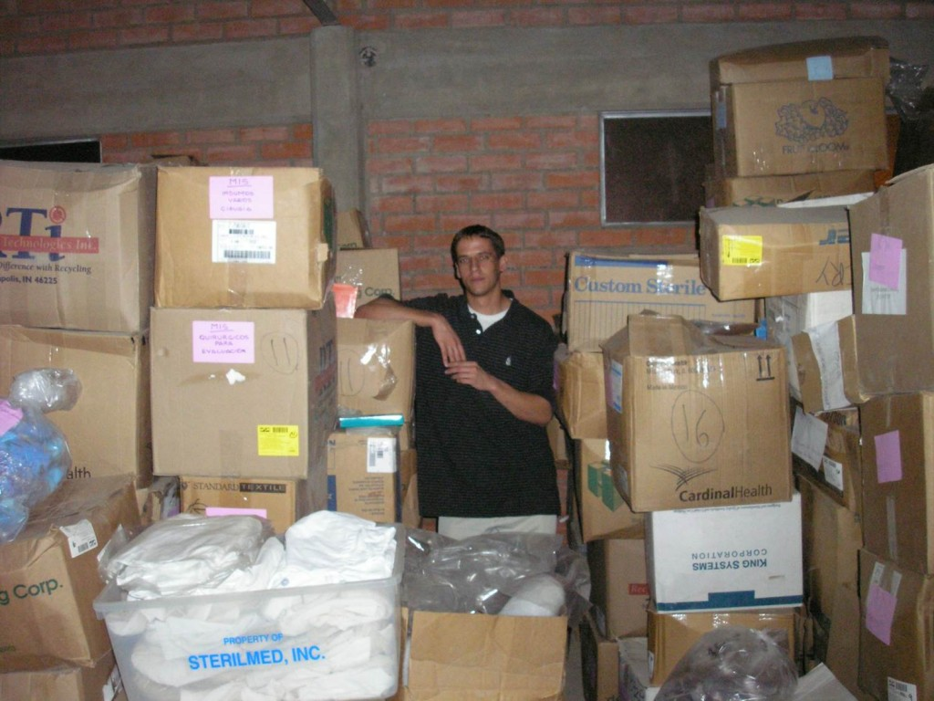Me among the boxes in Mano a Mano Bolivia's warehouse in Cochabamba in 2006 - I had taped each of these boxes in Minnesota, so it was gratifying to see them in Bolivia!