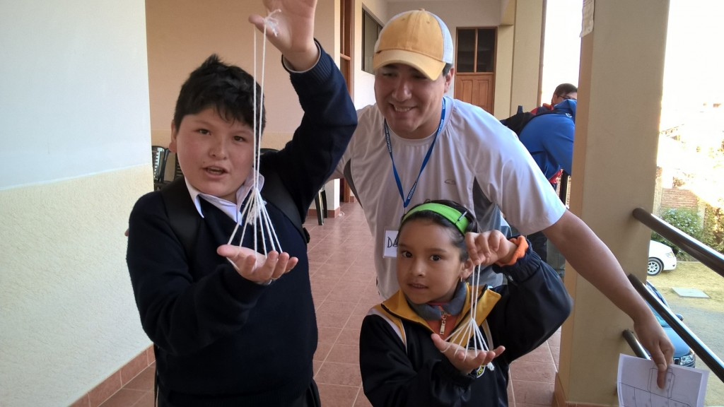 Daniel has a way with the kids. They love doing cat's cradle with him! From the Minnesota Teacher Trip to Bolivia - June 2016