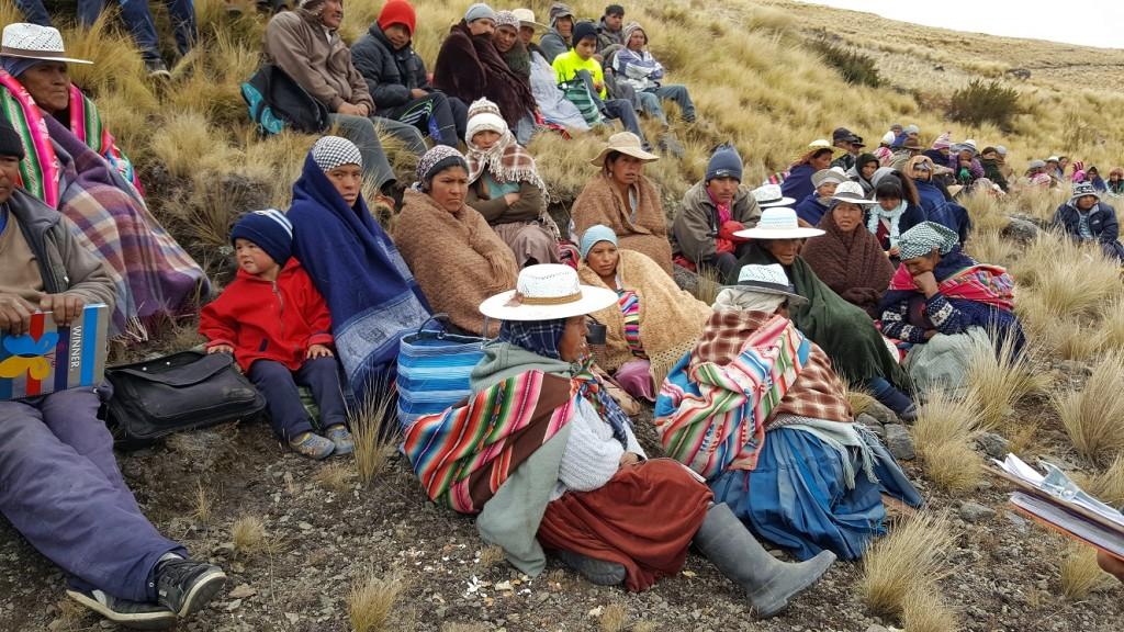 Residents of the Wirkini communty attending a meeting with Mano a Mano - which are held throughout the planning and construction process - at the site of the reservoir.
