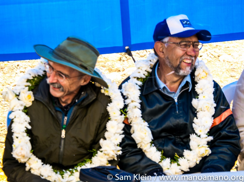 Mano a Mano volunteer Ray Wiedmeyer (left) and Mano a Mano co-founder Segundo Velasquez watch the celebration of Mano a Mano's water reservoir in Wirkini, October 2016.