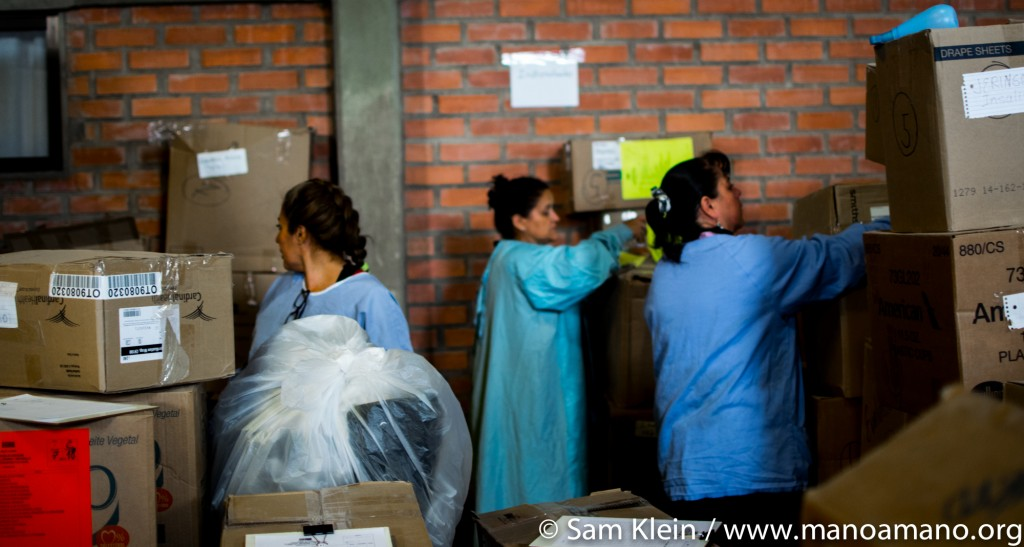 Bolivian volunteers work, often late into the night, sorting medical donations at Mano a Mano's warehouse. Both in the U.S. and in Bolivia, volunteers like these are crucial to Mano a Mano's success.