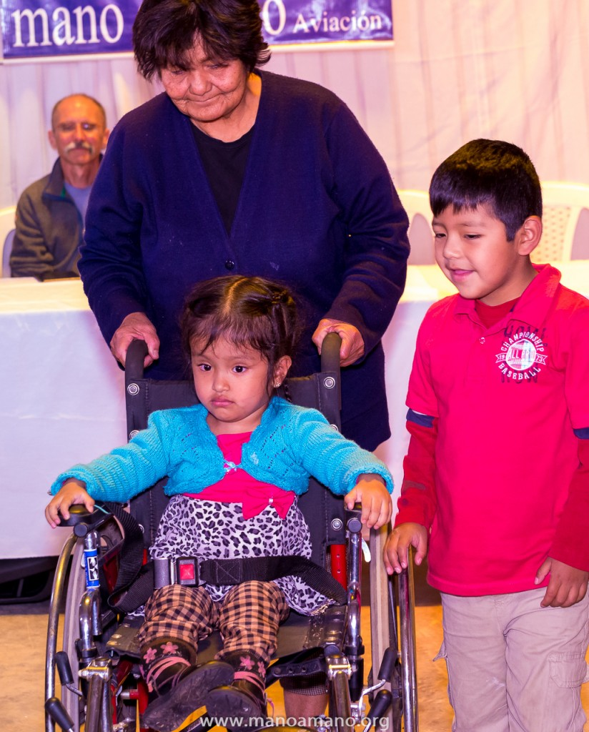 A child receiving a donated wheelchair at one of Mano a Mano's distribution events in Cochabamba, Bolivia, October 2016. More than 90,000 pounds of supplies were distributed to people & organizations throughout Bolivia in October.