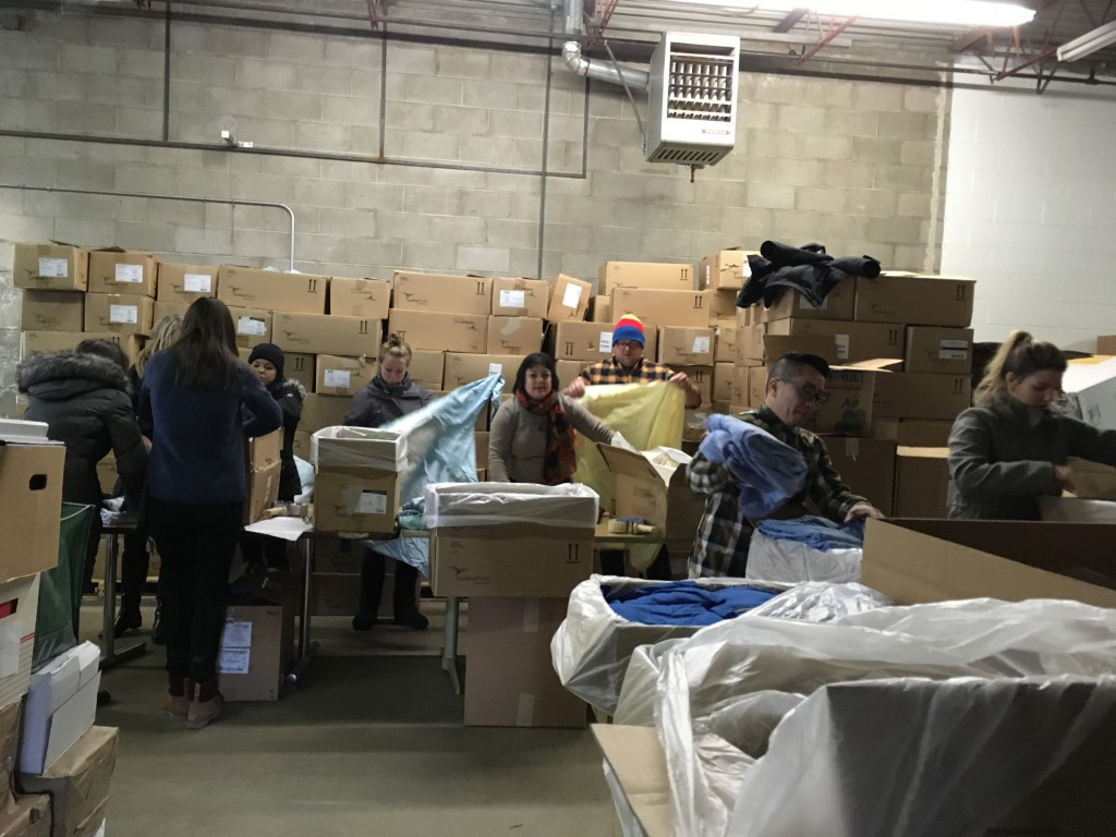 St. Kate's volunteers sorting donated hospital linens at Mano a Mano - January 13, 2017.