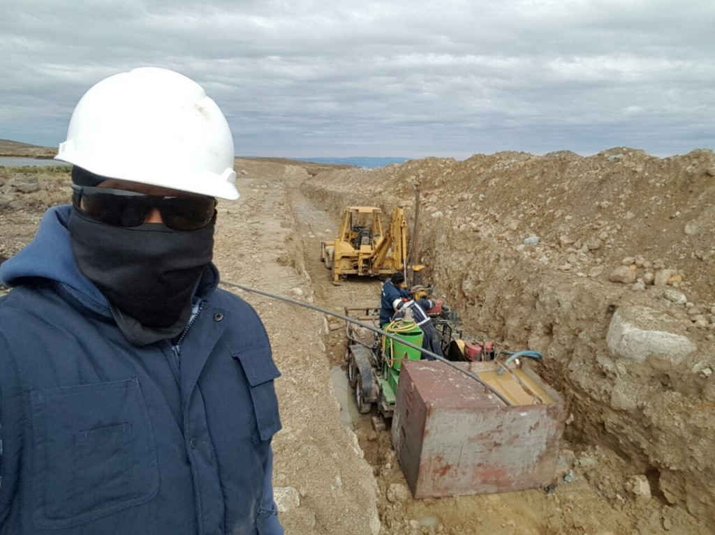 Mano a Mano Engineer Boris Roriguez working on the Maldonado water reservoir. As with many of our projects, the working conditions are difficult: it is about 14,000 feet above sea level, and it is cold, wet, and windy.