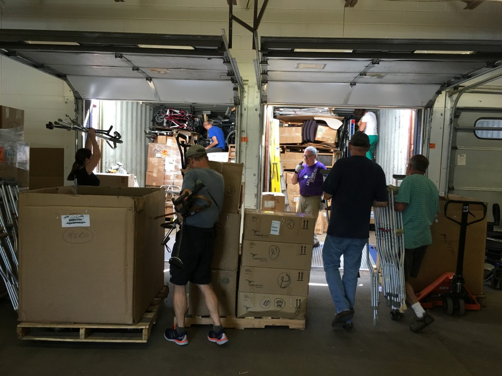 Volunteers working on loading 2 of the 5 containers at Mano a Mano - August 2017.
