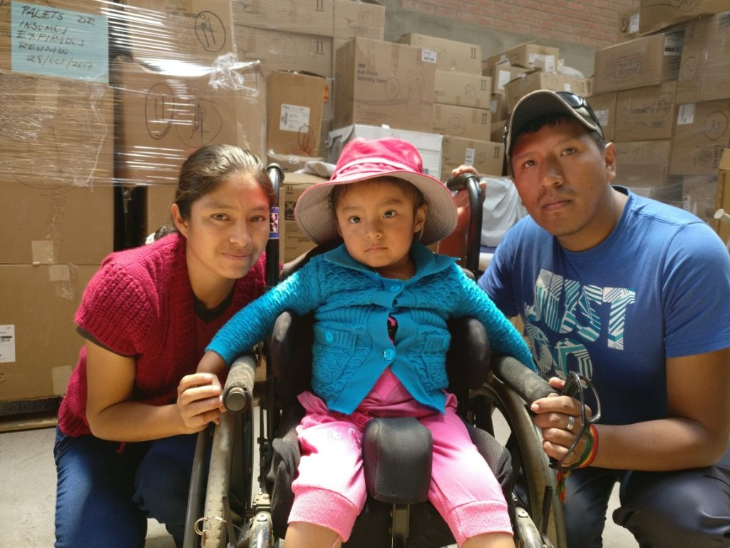 Gabriela, with her parents, in her new wheelchair from Mano a Mano in 2017.