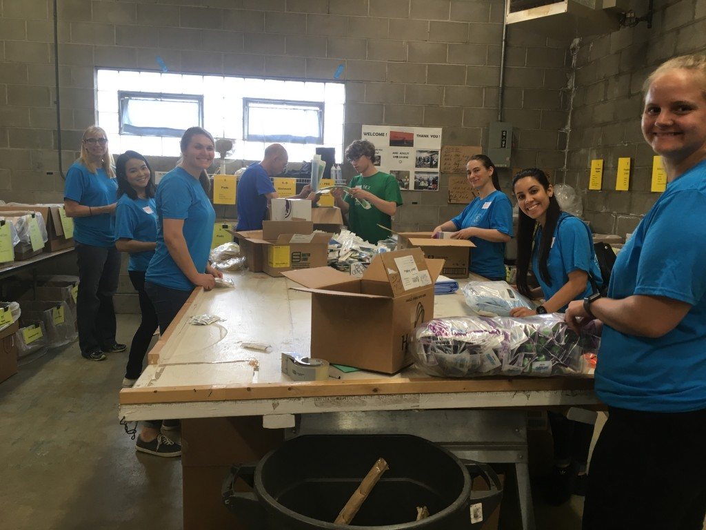 Volunteers from Northwestern Health Sciences University sort donated medical supplies at Mano a Mano on their annual Service & Appreciation Day, June 26, 2018.