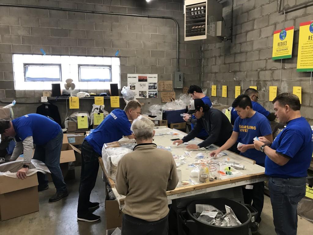 Samsung volunteers sorting donated medical supplies at Mano a Mano, October 12, 2018